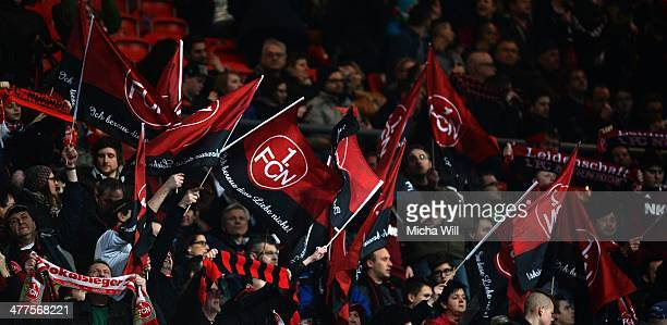 Fans wave flags shwoing the quote 'Ich bereue diese Liebe nicht' at the beginning of the Bundesliga match between 1 FC Nuernberg and Werder Bremen at...