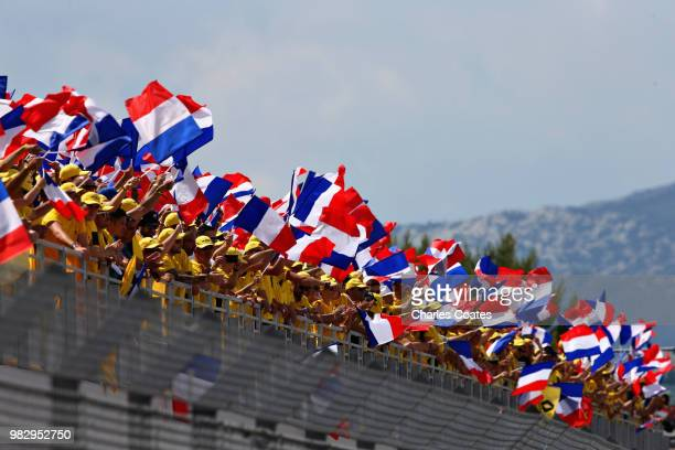 Fans wave French flags before the Formula One Grand Prix of France at Circuit Paul Ricard on June 24, 2018 in Le Castellet, France.