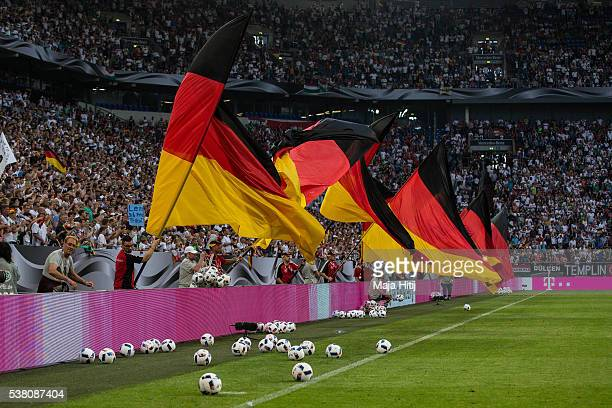 Fans wave German flags after the international friendly match between Germany and Hungary at VeltinsArena on June 5 2016 in Gelsenkirchen Germany...