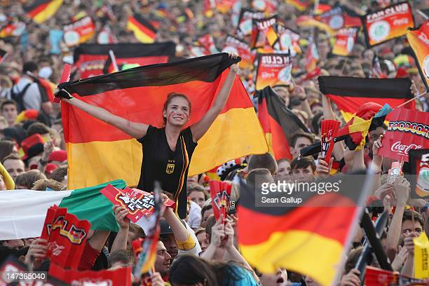 Fans wave German flags at the Fanmeile public viewing at Brandenburg Gate prior to the Germany vs Italy UEFA Euro 2012 semifinals match on June 28...