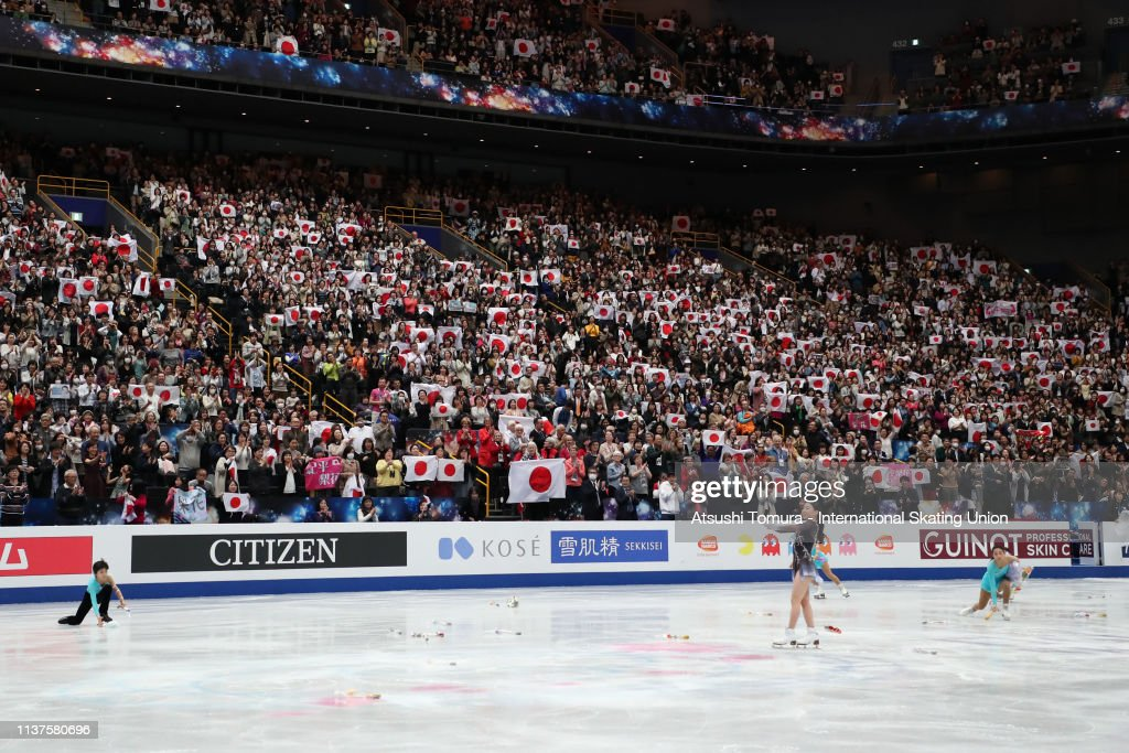 fans-wave-national-flags-as-rikakihira-of-japan-applauds-after-in-picture-id1137580696