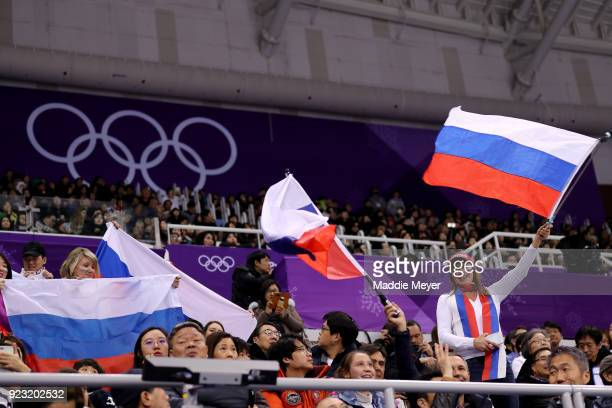 Fans wave Russian flags as Alina Zagitova of Olympic Athlete from Russia competes during the Ladies Single Skating Free Skating on day fourteen of...