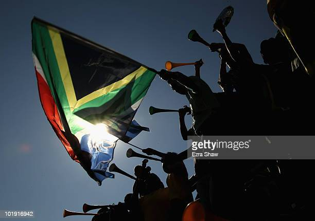 Fans wave South African flags and blow vuvuzela horns during the Bafana Bafana Parade to support the South African World Cup football team on June 9...