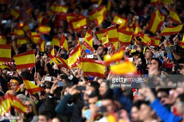 Fans wave Spanish flags prior to the International Friendly between Spain and Argentina on March 27 2018 in Madrid Spain