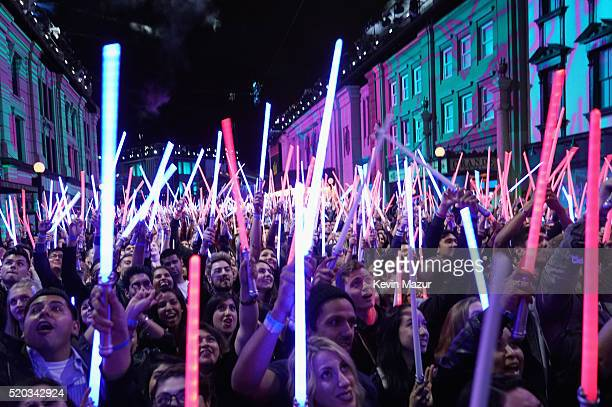 Fans wave 'Star Wars The Force Awakens' lightsabers during the 2016 MTV Movie Awards at Warner Bros Studios on April 9 2016 in Burbank California MTV...