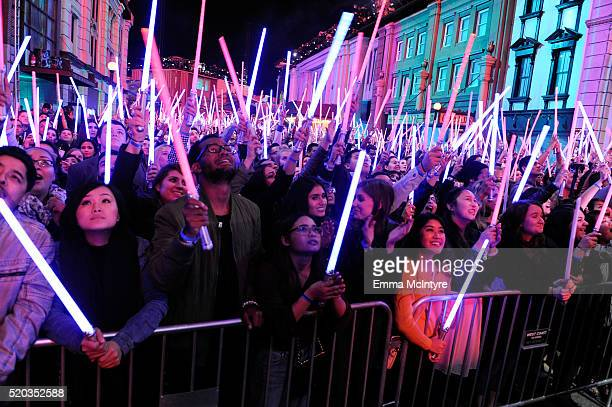 Fans wave 'Star Wars The Force Awakens' lightsabers onstage during the 2016 MTV Movie Awards at Warner Bros Studios on April 9 2016 in Burbank...