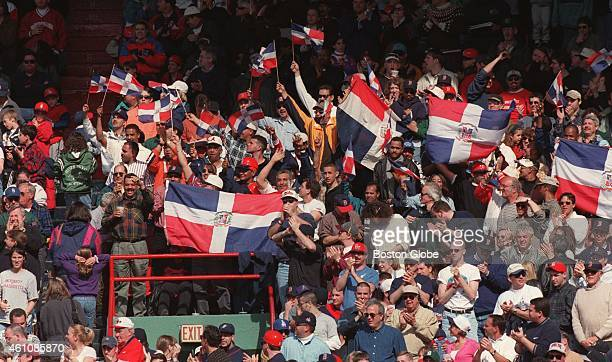 Fans wave the flag of the Dominican Republic for Pedro Martinez at a Red Sox game against Seattle on April 11, 1998.