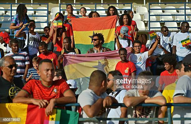 Fans wave the Ghanaian flag as they watch the Ghana national football team train at the Rei Pele stadium in Maceio on June 13 2014 Ghana will face...