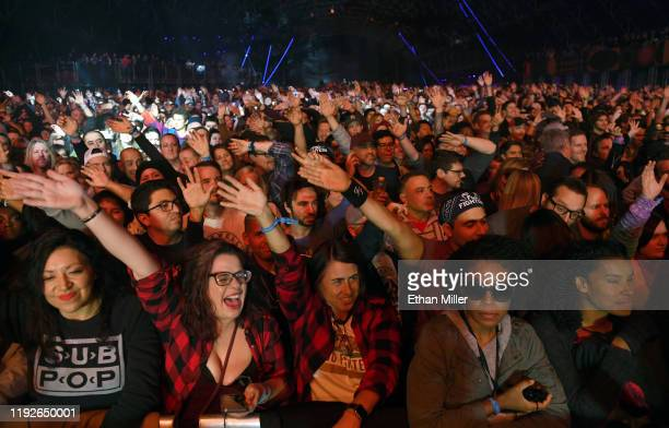 Fans wave their arms as they watch recording artist Anderson Paak of Anderson .Paak & The Free Nationals perform at the Intersect music festival at...
