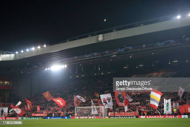 Fans wave their flags and banners in The Kop before the UEFA Champions League group E match between Liverpool FC and KRC Genk at Anfield on November...