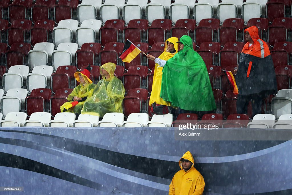 Fans wave their flags in the rain during the international friendly match between Germany and Slovakia at WWK-Arena on May 29, 2016 in Augsburg, Germany.