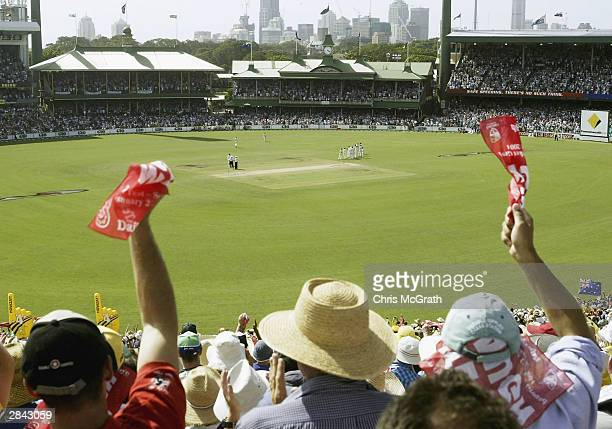 Fans wave their red rags in support for retiring Australian captain Steve Waugh as he walks out to bat during day three of the 4th Test between...