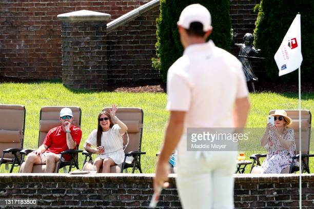 Fans wave to Rory McIlroy of Northern Ireland on the 7th green during the final round of the 2021 Wells Fargo Championship at Quail Hollow Club on...