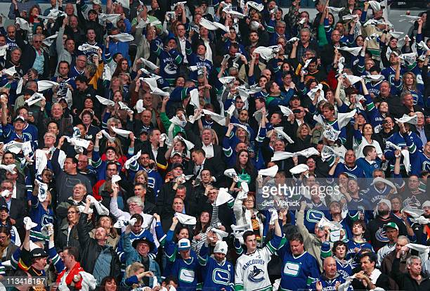Fans wave towels during Game Seven of the Western Conference quarterfinal between the Chicago Blackhawks and the Vancouver Canucks during the 2011...