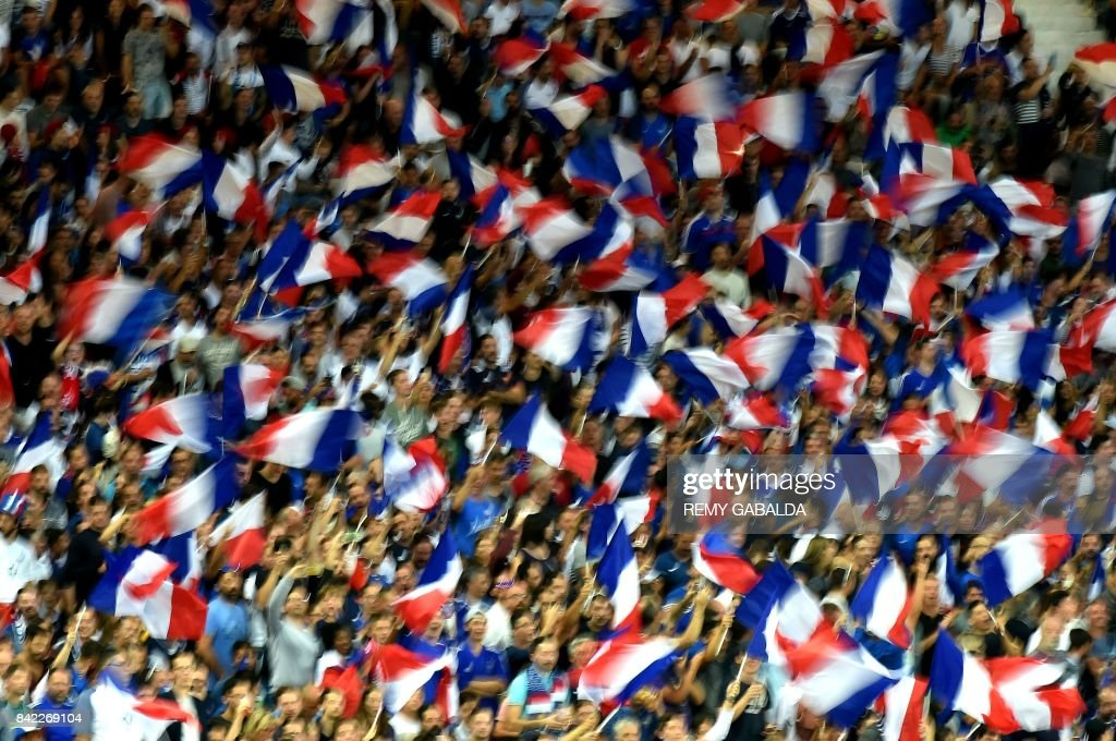 Fans waves the French flags during the FIFA World Cup 2018 qualifying football match France vs Luxembourg on September 3, 2017 at the Municipal Stadium in Toulouse, southern France. /