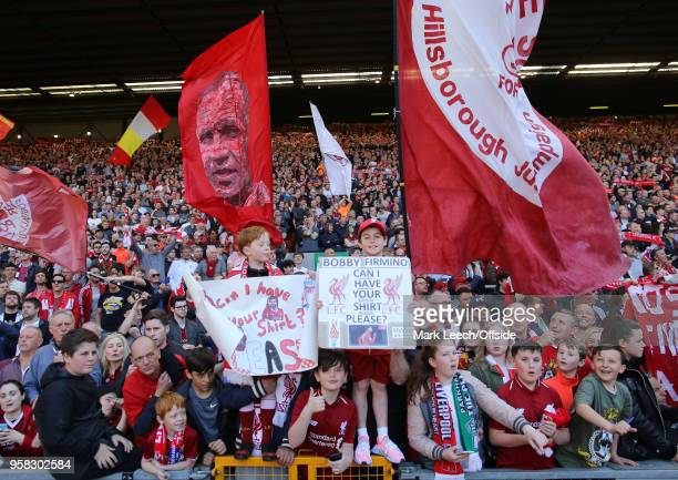 fans waving flags on the Spion Kop during the Premier League match between Liverpool and Brighton and Hove Albion at Anfield on May 13 2018 in...