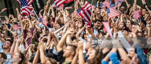 usa fans waving flags - the olympic games stock pictures, royalty-free photos & images