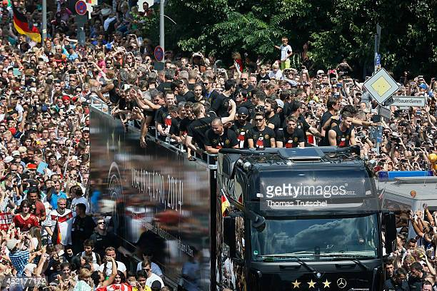 Fans waving the German national soccer team near Reichstag building on July 15 2014 in Berlin Germany Thousands of football fans celebrate the German...