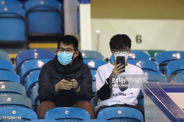 Fans wear a disposable face mask prior to the FA Cup Fifth Round match between Sheffield Wednesday and Manchester City at Hillsborough on March 04,...