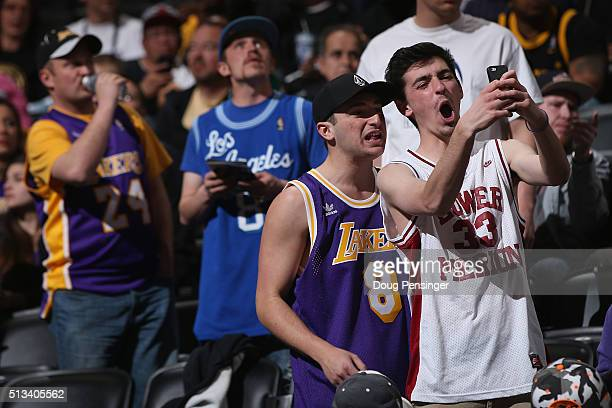 Fans wear an array of jerseys as they attend the game to see Kobe Bryant of the Los Angeles Lakers face the Denver Nuggets in his final game at Pepsi...