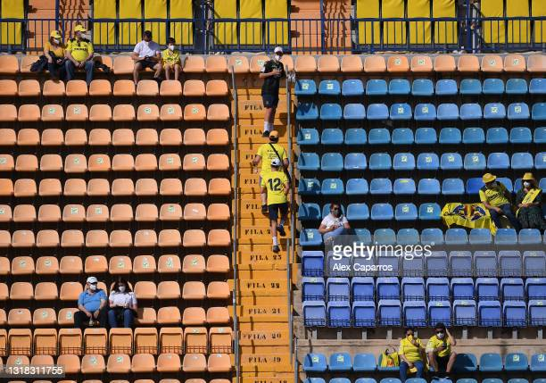 Fans wear face masks and social distance as they wait in their seats prior to the La Liga Santander match between Valencia CF and SD Eibar at Estadio...