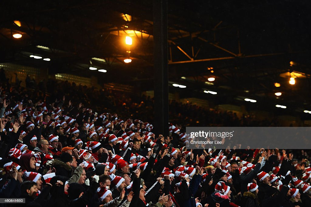 Fans wear 'Father Christmas' style hats during the Barclays Premier League match between Crystal Palace and Southampton at Selhurst Park on December 26, 2014 in London, England.