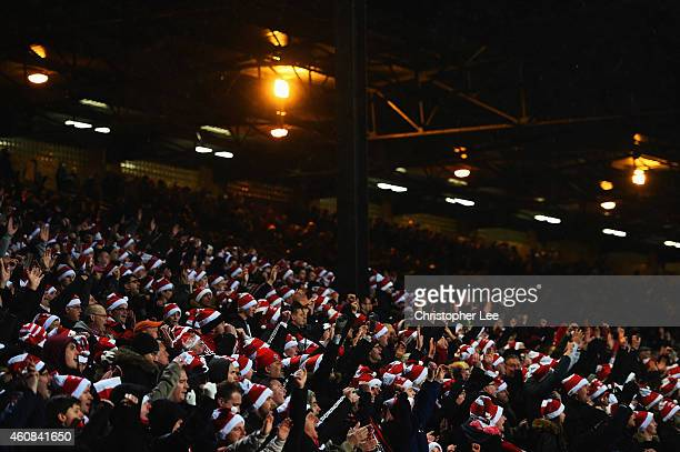 Fans wear 'Father Christmas' style hats during the Barclays Premier League match between Crystal Palace and Southampton at Selhurst Park on December...