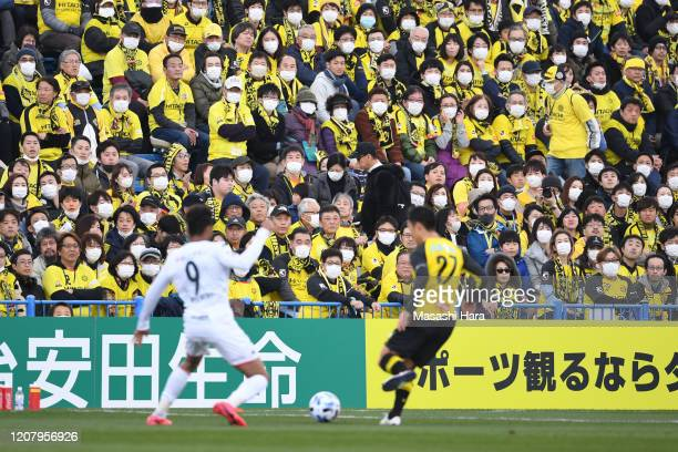 Fans wear masks to prevent the transmission of the COVID-19 during the J.League MEIJI YASUDA J1 match between Kashiwa Reysol and Consadole Sapporo at...