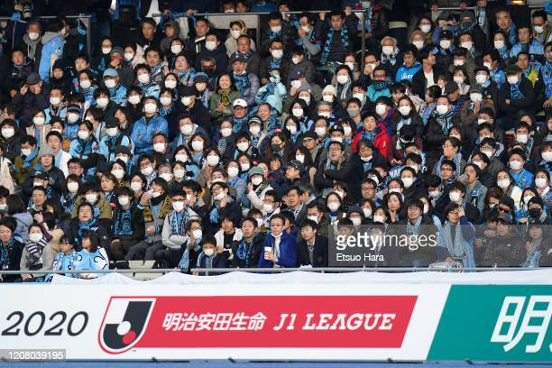 Fans wear masks to protect themselves from coronavirus during the JLeague MEIJI YASUDA J1 match between Kawasaki Frontale and Sagan Tosu at Todoroki...