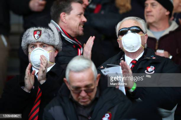 Fans wear masks to the match during the Premier League match between AFC Bournemouth and Chelsea FC at Vitality Stadium on February 29, 2020 in...