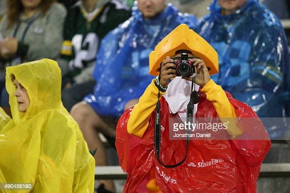 the latest 34994 79ac1 Fans wear rain gear prior to the start of the NFL game ...