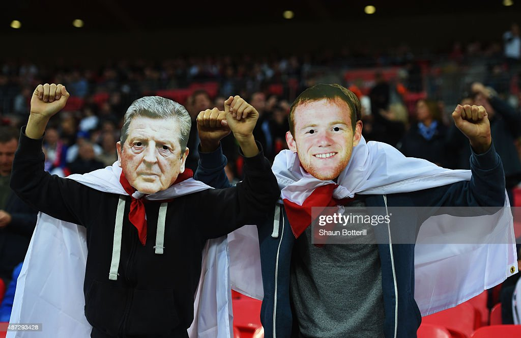 Fans wear Roy Hodgson and Wayne Rooney masks prior to the UEFA EURO 2016 Group E qualifying match between England and Switzerland at Wembley Stadium on September 8, 2015 in London, United Kingdom.