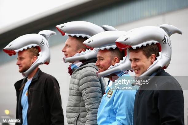 Fans wear 'shark heads' in honour of Benjamin Mendy prior to the Premier League match between Manchester City and Burnley at Etihad Stadium on...