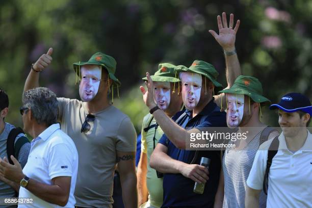 Fans wear Sky Commentator Wayne Riley masks during day two of the BMW PGA Championship at Wentworth on May 26 2017 in Virginia Water England