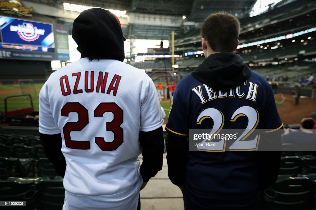 competitive price 89912 3a2fb Fans wear uniforms of Marcell Ozuna of the St. Louis ...
