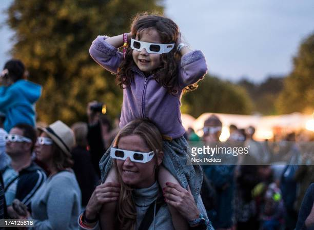 Fans wearing 3D glasses watch Kraftwerk perform at day 3 of the Latitude Festial at Henham Park Estate on July 20 2013 in Southwold England