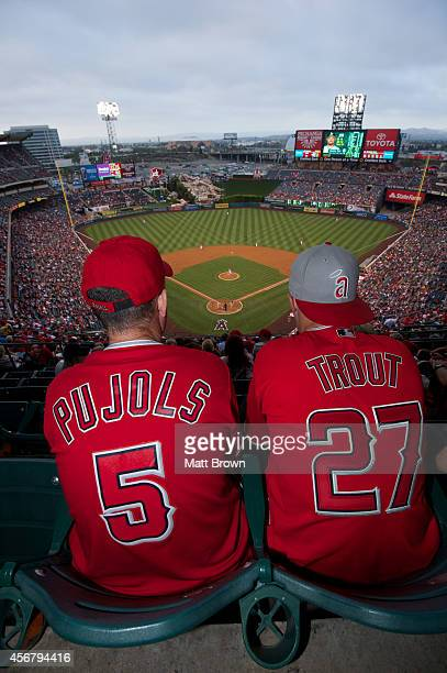 Fans wearing Albert Pujols and Mike Trout jerseys watch the game between the Oakland Athletics and Los Angeles Angels on June 9 2014 at Angel Stadium...