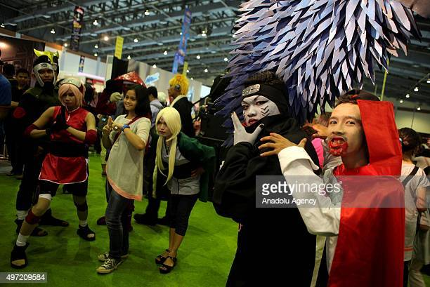 Fans wearing costumes attend the Jakarta Comic Con 2015 at Jakarta Convention Centre in Jakarta Indonesia on November 15 2015
