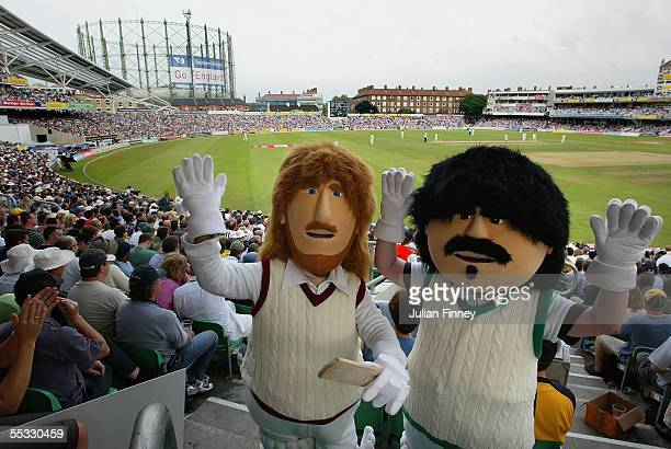 Fans wearing dressed as the characters 'Beefy' and 'Lamby' wave as they enjoy day three of the fifth npower Ashes Test match between England and...