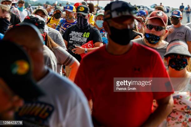 Fans wearing face masks and face coverings enter the race track prior to the NASCAR Cup Series All-Star Race at Bristol Motor Speedway on July 15,...