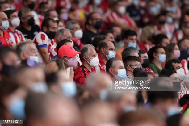 Fans wearing face masks look on during the La Liga Santander match between Club Atletico de Madrid and Villarreal CF at Estadio Wanda Metropolitano...