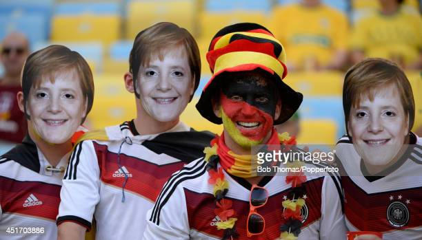 Fans wearing face masks of German Chancellor Angela Merkel prior to the 2014 FIFA World Cup Brazil Quarter Final match between France and Germany at...