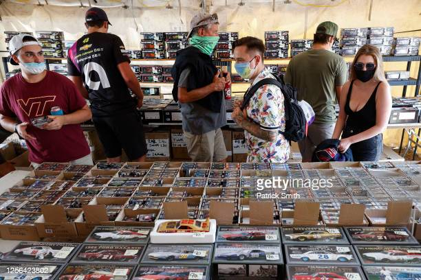 Fans wearing face masks shop for race memorabilia prior to the NASCAR Cup Series All-Star Race at Bristol Motor Speedway on July 15, 2020 in Bristol,...