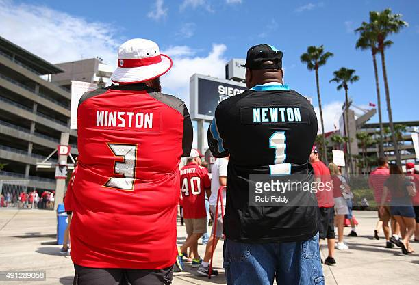Fans wearing Jameis Winston of the Tampa Bay Buccaneers and Cam Newton of the Carolina Panthers jerseys pose for a photo before of the game at...