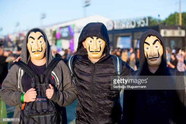 Fans wearing masks enjoy the atmosphere during Royal Blood set during the first day of Lollapalooza Buenos Aires 2018 at Hipodromo de San Isidro on...