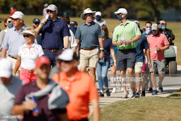 Fans, wearing masks, walk down a path during the second round of the Houston Open at Memorial Park Golf Course on November 06, 2020 in Houston,...