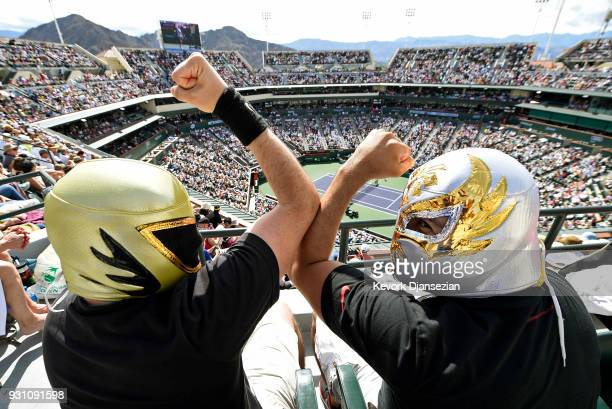 Fans wearing Mexican wrestler masks watch the tennis match between Roger Federer of Switzerland and Filip Krajinovic of Serbia during Day 8 of BNP...