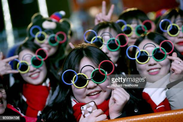 Fans wearing Olympic ring glasses pose during the Medal Ceremony on nine one of the PyeongChang 2018 Winter Olympic Games at Medal Plaza on February...