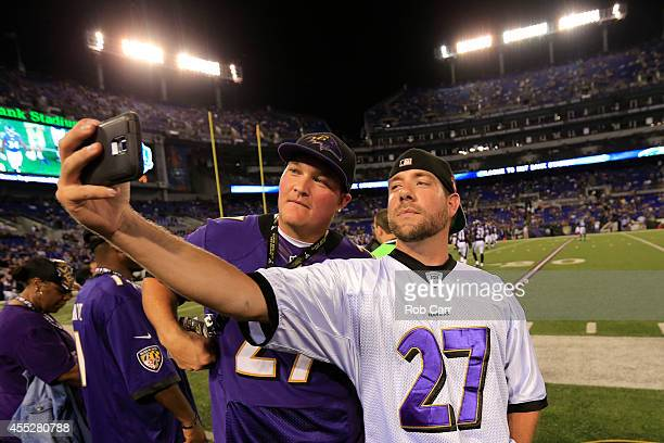Fans wearing Ray Rice jerseys on the sidelines during pregame take a selfie before the game between the Baltimore Ravens and the Pittsburgh Steelers...
