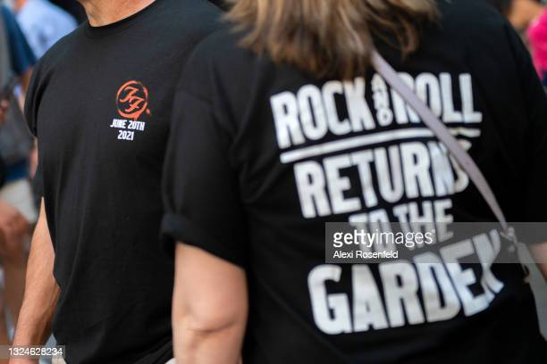Fans wearing the official Foo Fighters t-shirts walk into the Foo Fighters concert at Madison Square Garden on June 20, 2021 in New York City. The...